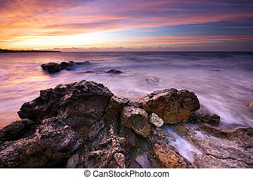 Beautiful sea scape. Sea and rock at the sunset. Nature ...