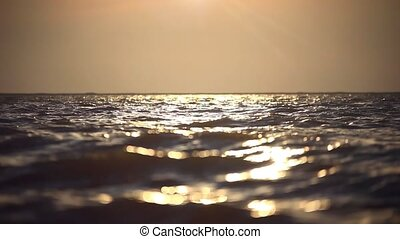 Beautiful sea wave and sky at sunset. Changes focus from...