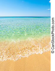 Beautiful sea with turquoise water and golden beach in ...