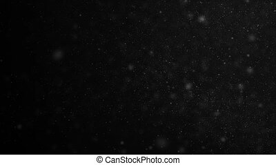 Beautiful Seamless Dust Particles Close-up Flying in the Wind on Black Background in Slow Motion. Looped 3d Animation of Floating Dots in the Air With Bokeh. 4k Ultra HD 3840x2160