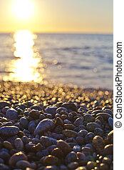 Beautiful seascape, amazing view of pebble coastline.