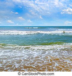 Beautiful seascape and blue sky. Sand beach.
