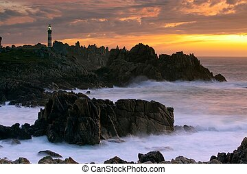 ouessant island beautiful landscape at dusk with creach lighthouse illuminated, brittany, france