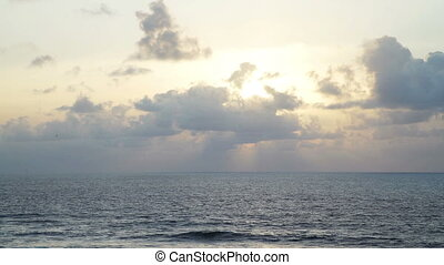 Beautiful seascape, light beam shining through cloudscape...