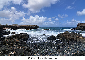 Beautiful Seascape of Aruba's Black Pebble Beach in Aruba
