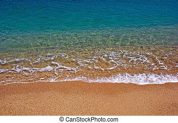 Beautiful seascape on the beach of Lloret de Mar, Costa Brava, Spain.