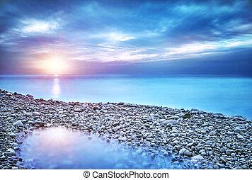 Beautiful seascape, amazing view of pebble coastline in mild...