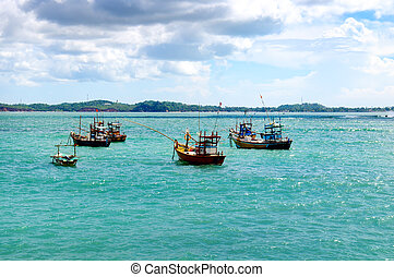 Beautiful seascape with fishing boats on the water.