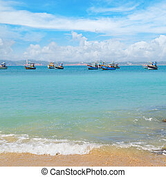 beautiful seascape with fishing boats on the water