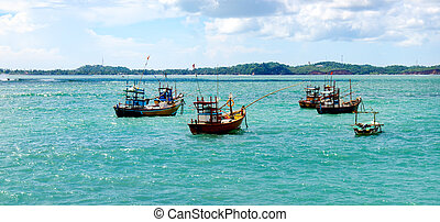 Beautiful seascape with fishing boats on the water. Wide photo.