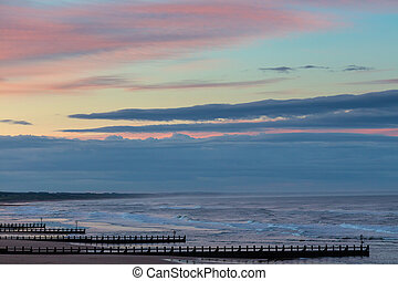 Beautiful seascape with pier at sunset time.