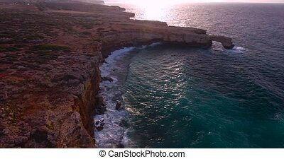 beautiful seashore with clifs at sunset - aerial view of...