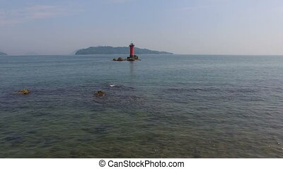 beautiful seaside with lighthouse - aerial drone flying over...