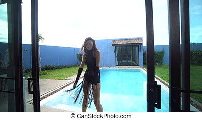 Beautiful seductive brunette woman in a luxurious villa -...