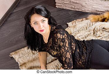 Beautiful seductive woman in black