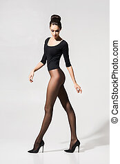 Beautiful, seductive woman posing in hosiery and heels over...