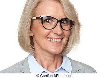 Beautiful senior business woman in eyeglasses