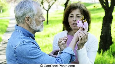 Beautiful senior couple in love outside in spring nature....