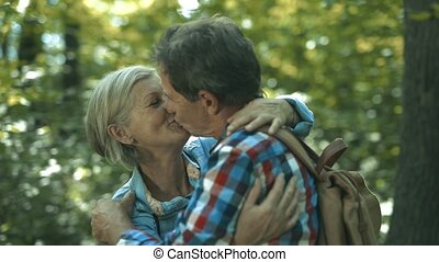 Beautiful senior couple on a walk on sunny summer day