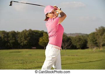 beautiful senior female golf player