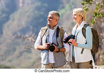 senior hikers enjoying outdoor activity - beautiful senior...