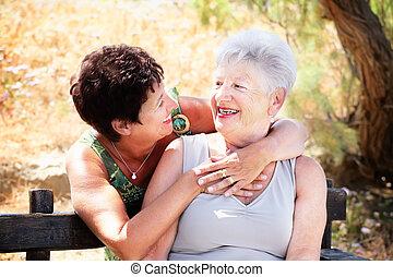Beautiful senior mother and daughter having fun