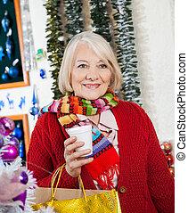 Beautiful Senior Woman At Christmas Store