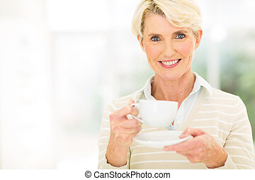 senior woman having coffee