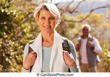 beautiful senior woman hiking in the mountain