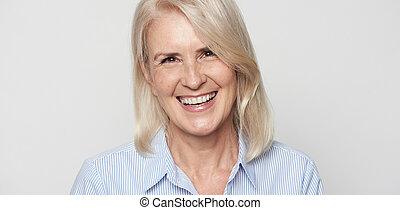Beautiful senior woman is smiling. Isolated.