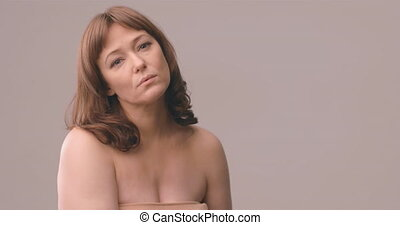 Beautiful senior woman serious look at camera. Mature woman ...