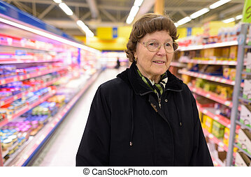 Beautiful senior woman shopping at the grocery store