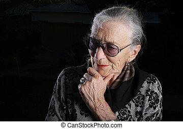 Beautiful senior woman thinking