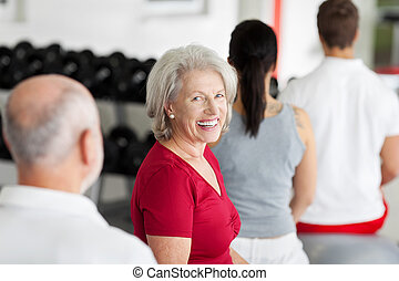 Beautiful senior woman training in a gym