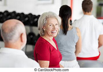 Beautiful senior woman training in a gym