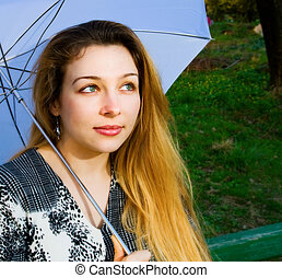 Beautiful sensual blond woman with umbrella