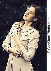 girl standing in the rain