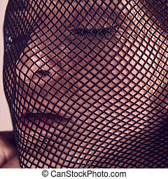 Beautiful sensual woman in a black veil on her face.