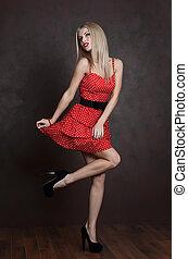 Beautiful sensual woman in red dress