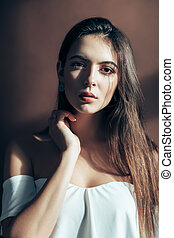 Beautiful sensual woman portrait on brown background