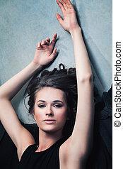 Beautiful Sensual Woman Relaxing. Brunette Fashion Model in Black