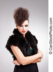 glamour woman in black dress with fur