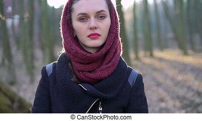 Beautiful serious girl looking at the camera. 4k