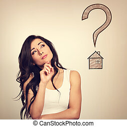 Beautiful serious thinking woman looking up on illustration house and big question and asking. Insurance protection concept, investment to safety money. Vintage color style
