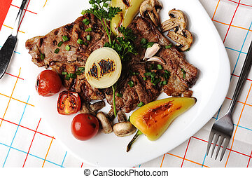 Beautiful served food on plate, meat with natural vegetables ingredients