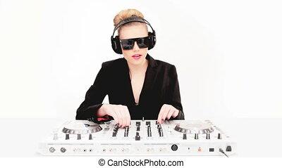 Beautiful sexy blond DJ in sunglasses