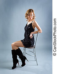sexy blond girl sitting on chair