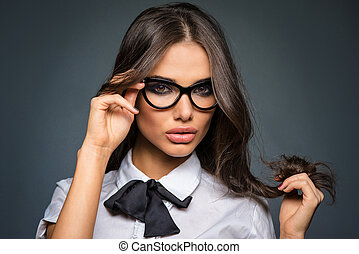 Beautiful sexy brunette young business woman wearing diopter glasses