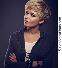 Beautiful sexy business woman with short bob blond hairstyle in fashion jacket on grey background. Closeup toned portrait