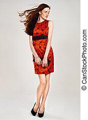 Beautiful sexy caucasian woman in stylish dress. Studio shot